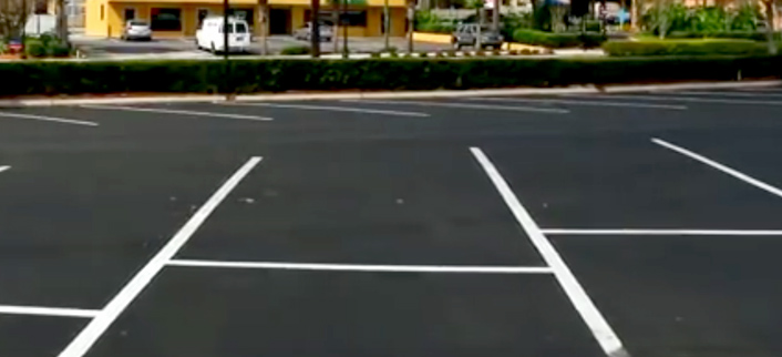 sealcoating in Orlando - newly sealcoated and striped lot
